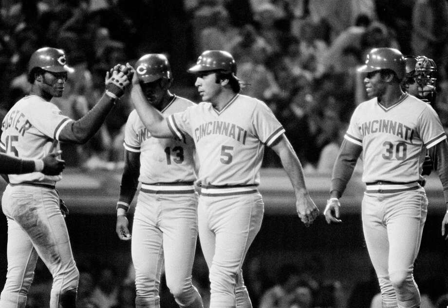 FILE PHOTO: Cincinnati Reds' catcher Johnny Bench (5) gets a high-five from George Foster, left, as he and Dave Concepcion (13) and Ken Griffey (30) all scored on Bench's grand-slam home run over the left field wall against the Los Angeles Dodgers, at Dodger Stadium, Sept. 20, 1980. (AP Photo/Reed Saxon) Photo: Reed Saxon / AP / 1980 AP