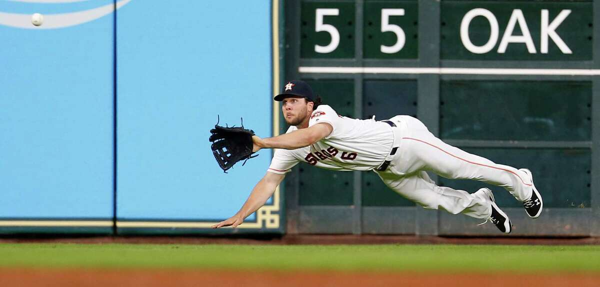 Houston Astros left fielder Jake Marisnick (6) dives to catch Arizona Diamondbacks Paul Goldschmidt's line out in the third inning of an MLB baseball game at Minute Maid Park, Wednesday, June 1, 2016, in Houston.