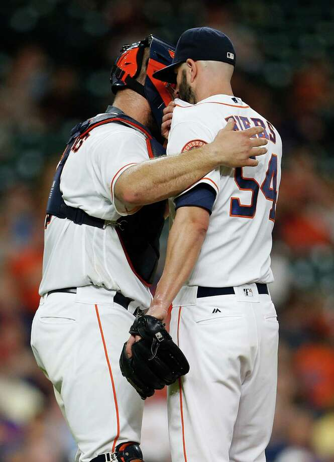 Houston Astros designated hitter Evan Gattis (11) chats with starting pitcher Mike Fiers (54) in the third inning of an MLB baseball game at Minute Maid Park, Wednesday, June 1, 2016, in Houston. Photo: Karen Warren, Houston Chronicle / © 2016 Houston Chronicle