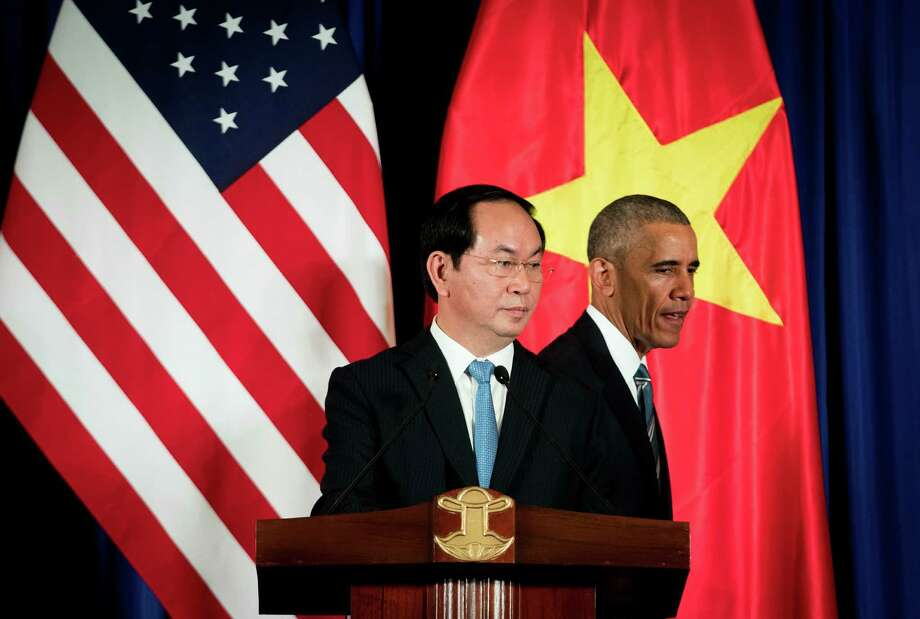 President Barack Obama and Vietnamese President Tran Dai Quang hold a news conference in Hanoi last week. Supporters of the Trans-Pacific Partnership hope Congress will approve the disputed trade deal after Election Day.  Photo: DOUG MILLS, STF / NYTNS