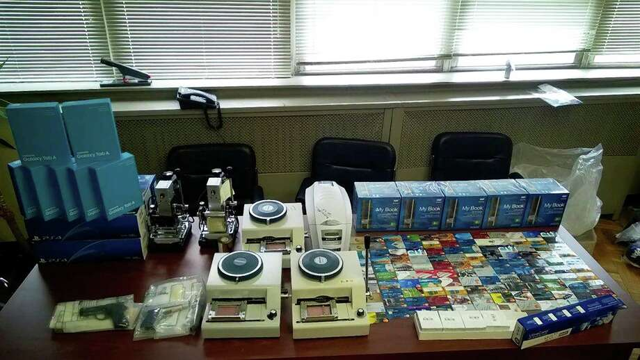 An undated handout photo from the police of credit card related and other items seized during a raid on associates of the Pop Out Boyz. Members of the Brooklyn based group and their associates have been arrested and charged with crimes related to credit card fraud, something they sang about in a single released in the spring. (New York Police Department via The New York Times) -- FOR EDITORIAL USE ONLY Photo: NEW YORK POLICE DEPARTMENT, HO / NEW YORK POLICE DEPARTMENT