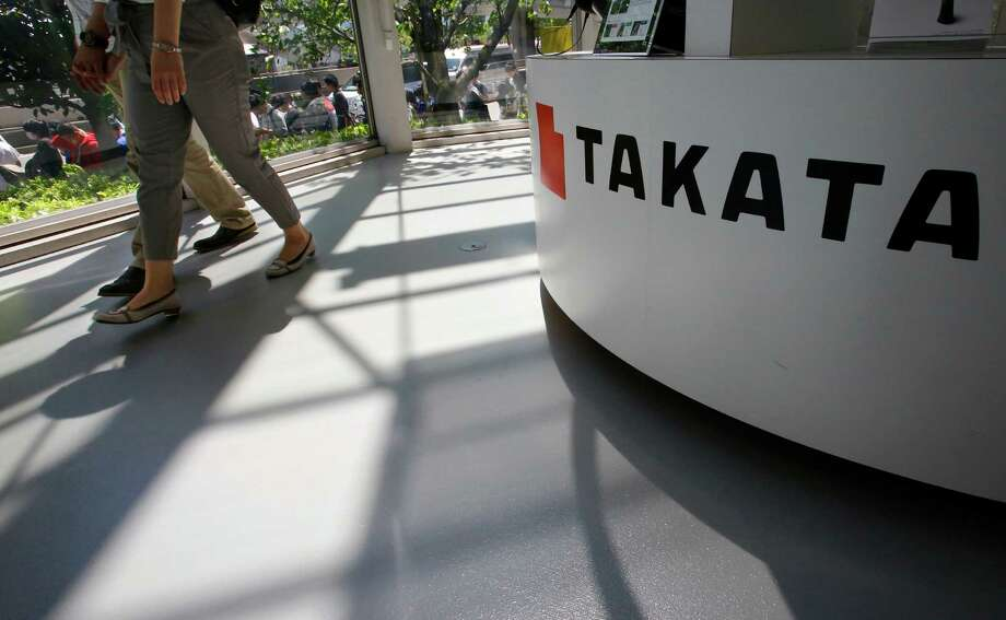 FILE - In this May 4, 2016, file photo, visitors walk by a Takata Corp. desk at an automaker's showroom in Tokyo. A U.S. Senate report says at least four automakers are selling new vehicles that have potentially deadly Takata air bag inflators. The report by Commerce Committee Democrats says some 2016 and 2017 models from Fiat Chrysler, Mitsubishi, Toyota and Volkswagen have a type of inflator that is prone to rupture and presents a potential danger to drivers and passengers. (AP Photo/Shizuo Kambayashi, File) Photo: Shizuo Kambayashi, STF / Copyright 2016 The Associated Press. All rights reserved. This material may not be published, broadcast, rewritten or redistribu