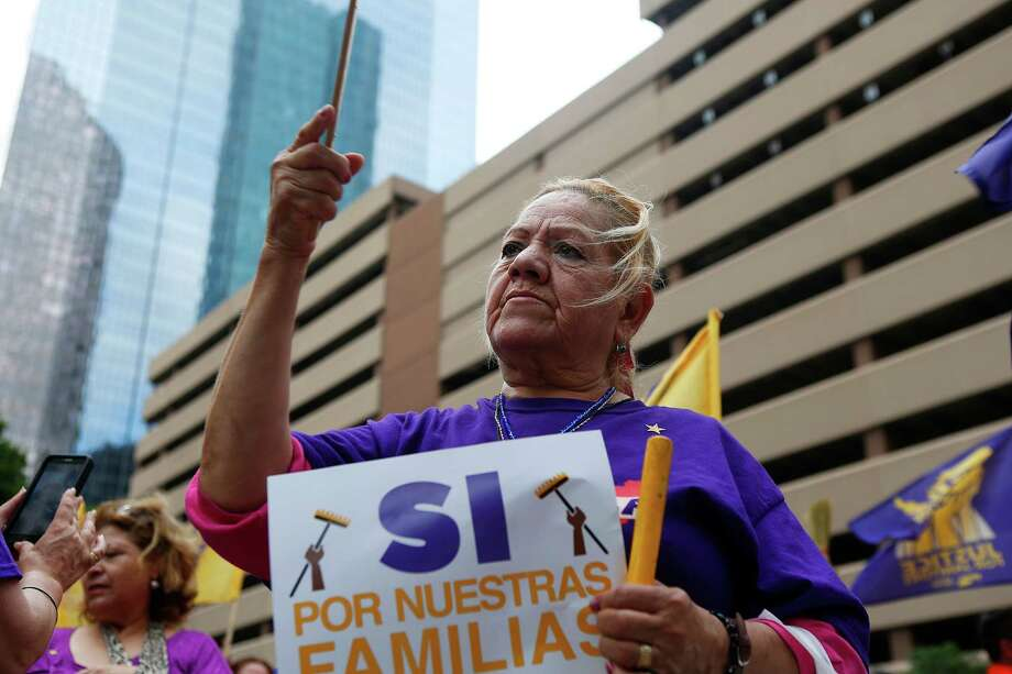 Janitors and their supporters rallied last week in front of One Allen Center downtown.  Photo: Mark Mulligan, Staff / © 2016 Houston Chronicle