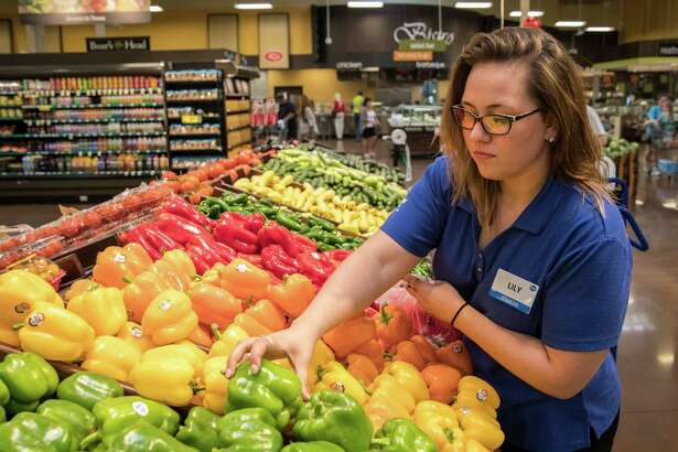 Lily Caudill picks fresh produce for a ClickList customer at Kroger Marketplace in Baytown, TX on Wednesday, June 1, 2016.