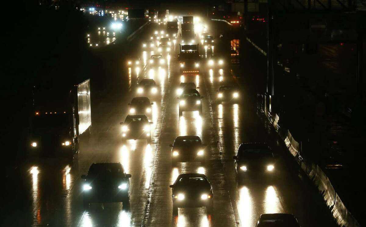 People drive on I-45 south of the Grand Parkway, after storms traveled through the area on June 1.