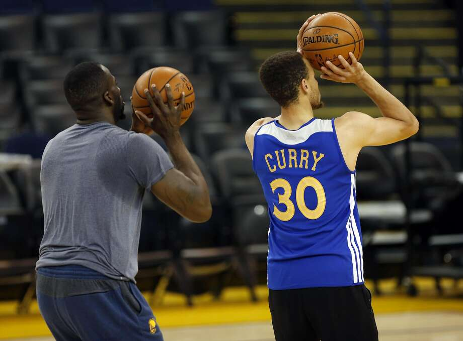 Draymond Green (left) and Stephen Curry take shots during practice at Oracle Arena in Oakland, California, on Wednesday, June 1, 2016. Photo: Connor Radnovich, The Chronicle