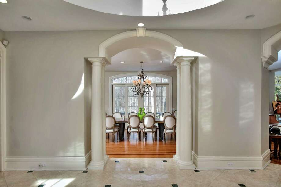 The dinning room can be seen from the foyer of the Westport home. Photo: Contributed / Contributed Photo / Westport News