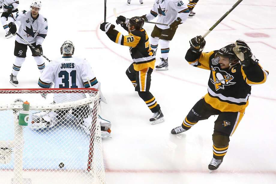 The Penguins' Patric Hornqvist (center) and Sidney Crosby (right) celebrate Conor Sheary's game-winner in overtime. Photo: Bruce Bennett, Getty Images