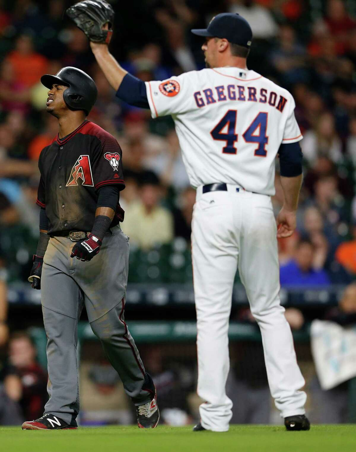 Arizona Diamondbacks second baseman Jean Segura (2) reacts after getting hit by a pitch from Houston Astros relief pitcher Luke Gregerson (44) in the ninth inning of an MLB baseball game at Minute Maid Park, Wednesday, June 1, 2016, in Houston.