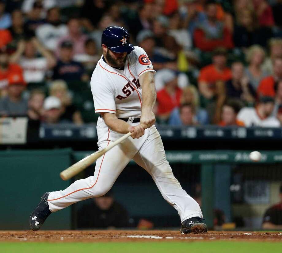 Houston Astros Evan Gattis (11) hits his two-run home run in the fifth inning of an MLB baseball game at Minute Maid Park, Wednesday, June 1, 2016, in Houston. ( Karen Warren  / Houston Chronicle ) Photo: Karen Warren, Staff / © 2016 Houston Chronicle