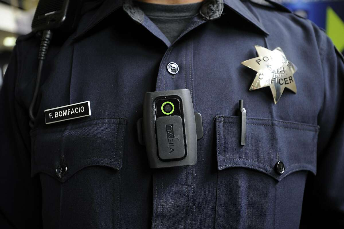 Officer Frank Bonifacio demonstrates a LE3 model of the Vievu body camera that patrol officers are now wearing, at OPD headquarters in Oakland, CA Wednesday, August 19, 2015.