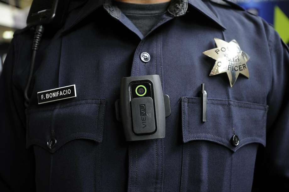 Officer Frank Bonifacio demonstrates a LE3 model of the Vievu body camera that patrol officers are now wearing, at OPD headquarters in Oakland, CA Wednesday, August 19, 2015. Photo: Michael Short, Special To The Chronicle