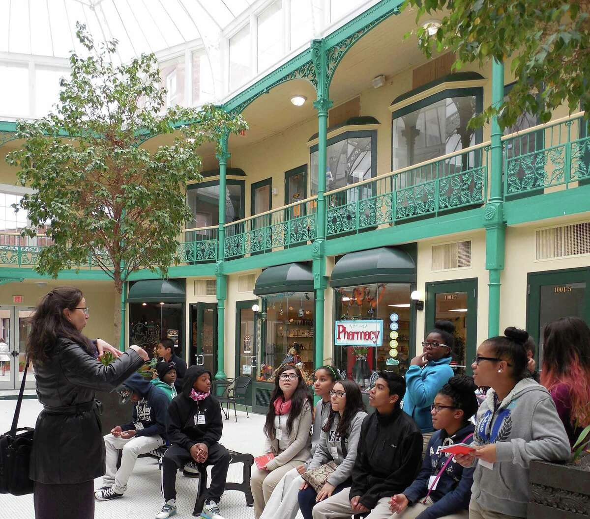 Janet Zamparo teaches peer docent students inside the Arcade Mall in Bridgeport. The Housatonic Museum of Art was awarded $15,000 from National Endowment for the Arts, funding a fourth year of the HMA Peer Docent Program.