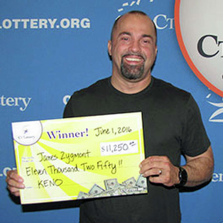James Zygmont, of Trumbull, claims $11,250 Keno prize at Lottery headquarters. He won the game by playing the numbers from an unclaimed $1 million Powerball drawing from Dec. 5, 2015. Photo: CT Lottery Photo