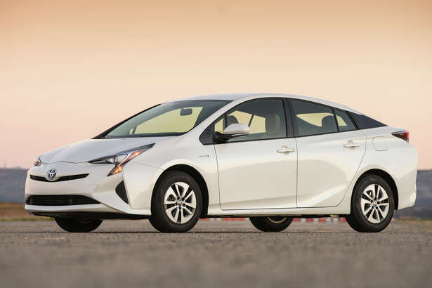 The 2016 Toyota Prius may not win any beauty contests, but the wind-cheating aerodynamics pay off in the quest for 50 mpg ratings.