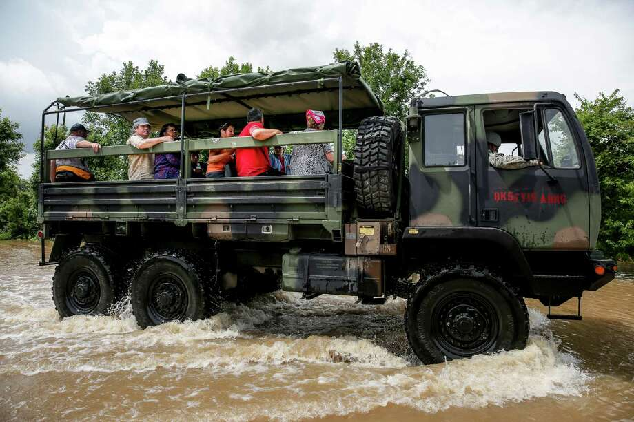 A rescue vehicle transports evacuees out of the flood zone Wednesday, June 1, 2016 in Booth. ( Michael Ciaglo / Houston Chronicle ) Photo: Michael Ciaglo, Staff / © 2016  Houston Chronicle
