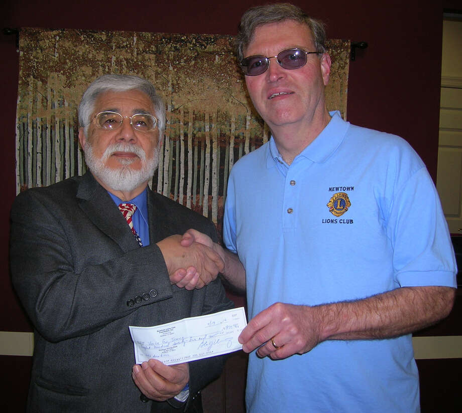 Voice for Joanie in New Milford recently received a donation of $875 from the Newtown Lions Club. Voice for Joanie, now in its 27th year, helps the victims of Lou Gehrigs Disease (Amyotrophic Lateral Sclerosis), six of whom reside in Newtown. The organization has directly supported 1,050 people. VFJ also supplies information and answers to queries from throughout the United States and Internationally. Above, Frank Ruiz, president of VFJ, left, receives the donation from Kevin Corey of the Newtown Lions Club. Photo: Courtesy Of Voice For Joanie / The News-Times Contributed