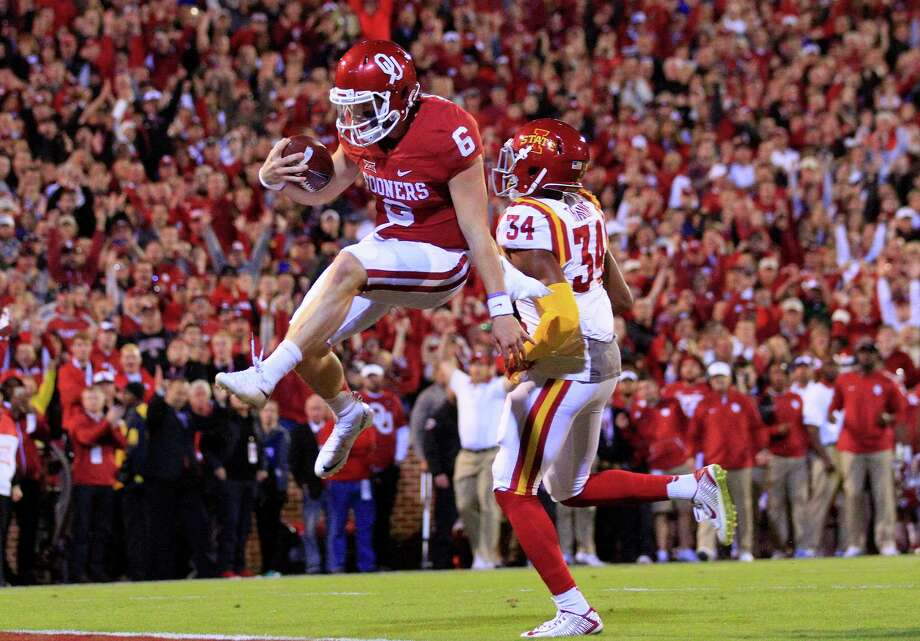 Oklahoma's Baker Mayfield, one of the nation's top QBs last year, will play his final season for the Sooners this fall. He can play one more season at a non-Big 12 school as a graduate transfer. Photo: Alonzo Adams / Associated Press / FR159426 AP