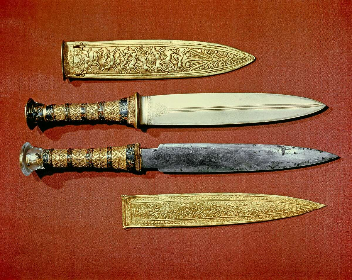 The king's two daggers, one with a blade of gold (top), the other of iron (bottom), from the tomb of the pharaoh Tutankhamun, discovered in the Valley of the Kings, Thebes, Egypt.