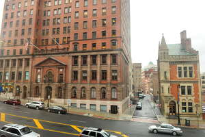 A Chinese businessman and other investors recently purchased 69 State St., left, and 63 State St., right, two historic buildings in downtown Albany for $4.4 million.