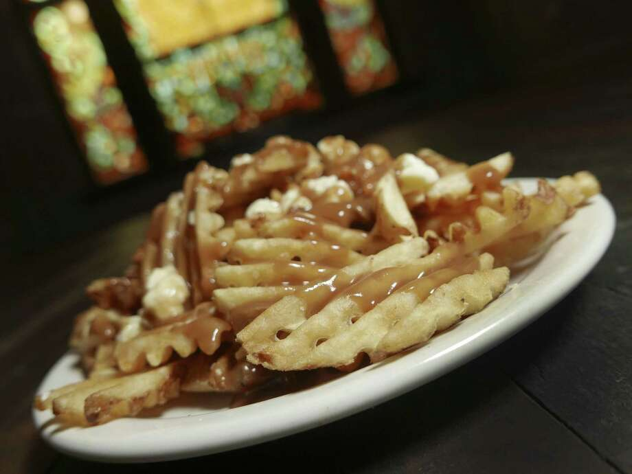 Frank, 1150 S. Alamo St., makes its poutine with waffle fries. Photo: Billy Calzada /San Antonio Express-News / San Antonio Express-News