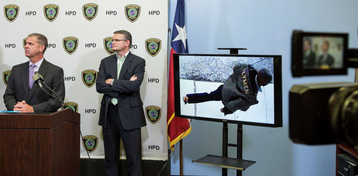 Sgt. Tommy Rulan, left, and Lt. John McGalin, of the Houston Police Department release surveillance video, showing a person of interest in the death of 11-year-old Josue Flores, during a news conference seeking information in the case on Thursday, June 2, 2016, in Houston.