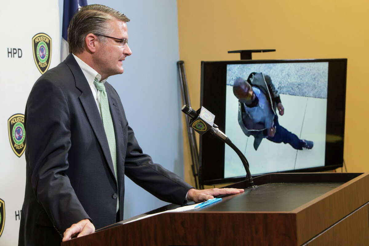 Lt. John McGalin, of the Houston Police Department talks about surveillance video, showing a person of interest in the death of 11-year-old Josue Flores, during a news conference seeking information in the case on Thursday, June 2, 2016, in Houston.