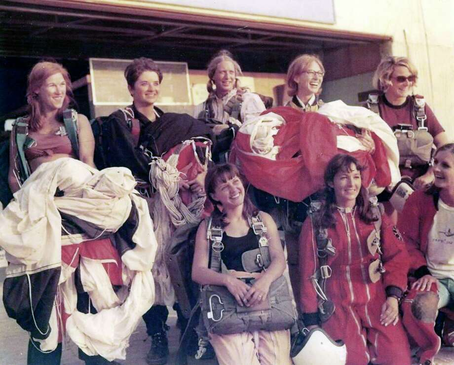 Luena Garrison, top row, fourth from left, is show with a group of other pioneering women parachutist in the '60s. She was a part of the first-ever eight-woman skydiving star formation. Photo: Courtesy Luena Garrison Sharma