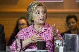 FILE-- Hillary Clinton, left, a Democratic presidential hopeful, participates in a community discussion with Oakland Mayor Libby Schaaf at the Home of Chicken and Waffles in Oakland, Calif., May 27, 2016. In 1998, then-president Bill Clinton suggested a partial solution to help millions of Americans without health insurance: The country should let those 55 and older without employer coverage buy into the government Medicare system. A few weeks ago, Clinton brought the idea back. (Andrew Burton/The New York Times)