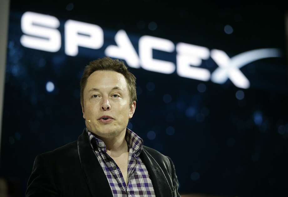 FILE - In this May 29, 2014, file photo, Elon Musk, CEO and CTO of SpaceX, introduces the SpaceX Dragon V2 spaceship at the SpaceX headquarters in Hawthorne, Calif. Musk predicted during an interview at the Code Conference in southern California on June 1, 2016, that people would be on Mars in 2025. (AP Photo/Jae C. Hong, File) Photo: Jae C. Hong, Associated Press