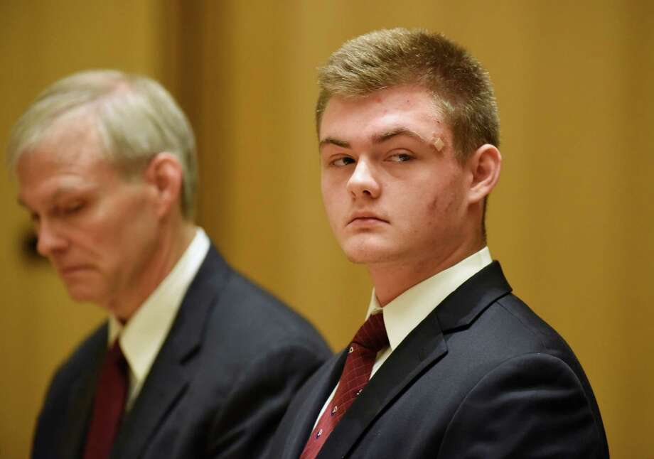 Andrew Schmidt, 17, of Greenwich, is arraigned at the Connecticut Superior Court in Stamford, Conn. Thursday, June 2, 2016. Schmidt is charged with evading responsibility in an accident that results in a fatality, a felony punishable by up to 10 years in prison, in connection with the hit-and-run collision that killed Edward Setterberg on April 17. At left is his father, James Schmidt. Photo: Tyler Sizemore / Hearst Connecticut Media / Greenwich Time