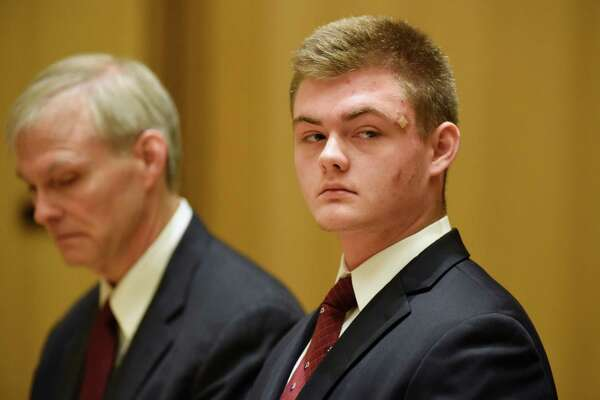 Andrew Schmidt, 17, of Greenwich, is arraigned at the Connecticut Superior Court in Stamford, Conn. Thursday, June 2, 2016. Schmidt is charged with evading responsibility in an accident that results in a fatality, a felony punishable by up to 10 years in prison, in connection with the hit-and-run collision that killed Edward Setterberg on April 17. At left is his father, James Schmidt.