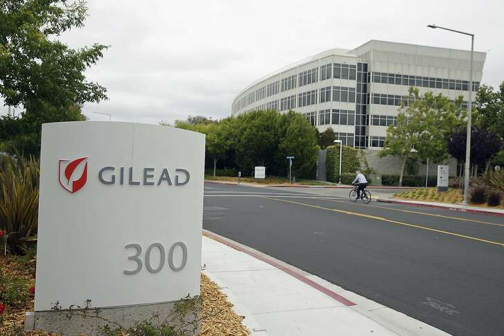 In this photo taken July 9, 2015, a man cycles near the headquarters of Gilead Sciences in Foster City, Calif. A bipartisan investigation by U.S. senators finds that the makers of a breakthrough drug for hepatitis C infection put profits before patients in pricing the $1,000-per-pill cure. The report released Tuesday by the Senate Finance Committee concludes that California-based Gilead Sciences was focused on maximizing revenue even as its own analysis showed a lower price would allow more patients to be treated for the liver-wasting disease. (AP Photo/Eric Risberg)
