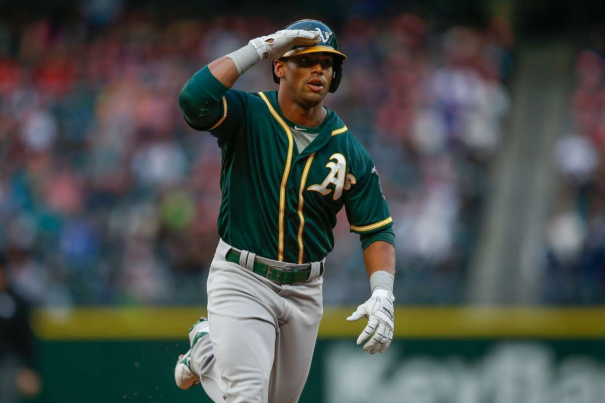 SEATTLE, WA - MAY 25: Khris Davis #2 of the Oakland Athletics rounds the bases after hitting a solo home run against the Seattle Mariners in the second inning at Safeco Field on May 25, 2016 in Seattle, Washington. (Photo by Otto Greule Jr/Getty Images)