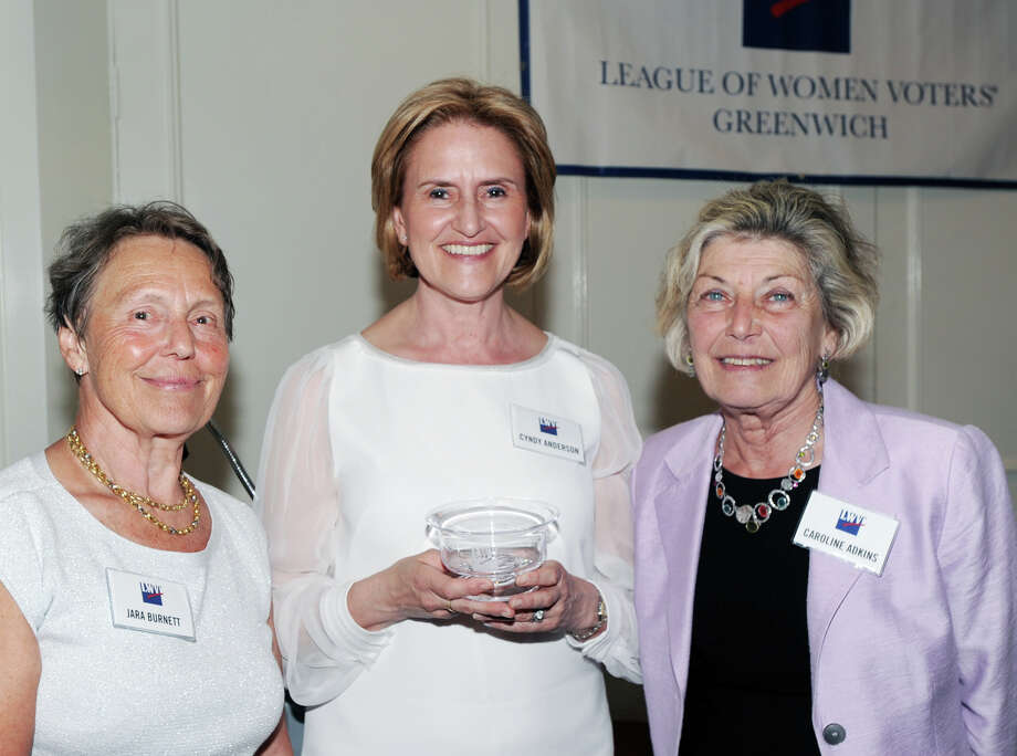 Pictured with fellow steering committee members, Jara Burnett, left, and Caroline Adkins, right, Cyndy Anderson of The League of Women Voters of Greenwich, center, was given her organization's highest honor, the Mary Award, for her many years of service to the Greenwich League and to the community during the League's annual meeting at the Riverside Yacht Club, Riverside, Conn., Wednesday, June 1, 2016. Photo: Bob Luckey Jr. / Hearst Connecticut Media / Greenwich Time