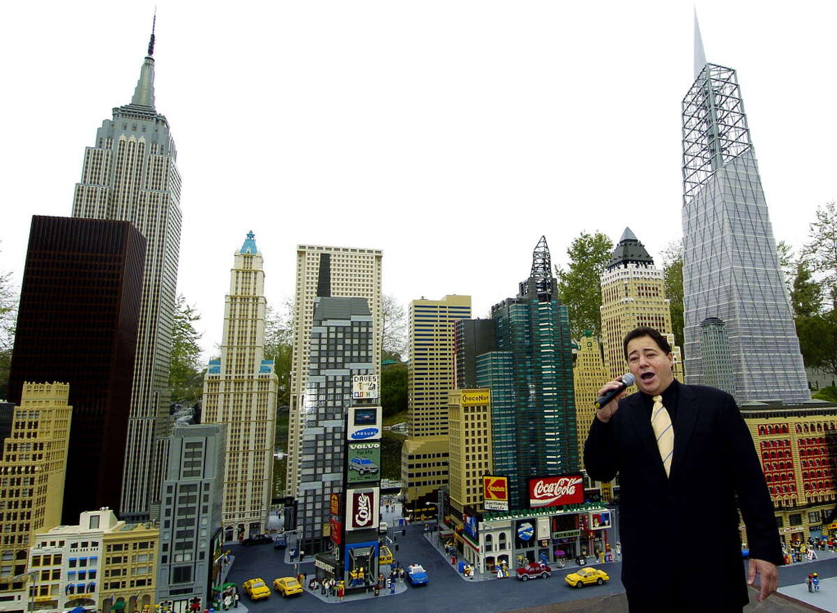 """In this photo released by LEGOLAND California, opera singer Daniel Rodriguez sings """"America the Beautiful,"""" in front of LEGO models of the New York skyline during the re-opening of Miniland New York at LEGOLAND California in Carlsbad, Calif., Friday, March 11, 2005. Included in the new exhibit is a 28-foot tall LEGO model of the World Trade Center site's planned Freedom Tower, far right, which took LEGO model builders four months to build, according to LEGO. (AP Photo/LEGOLAND California, Denis Poroy)"""