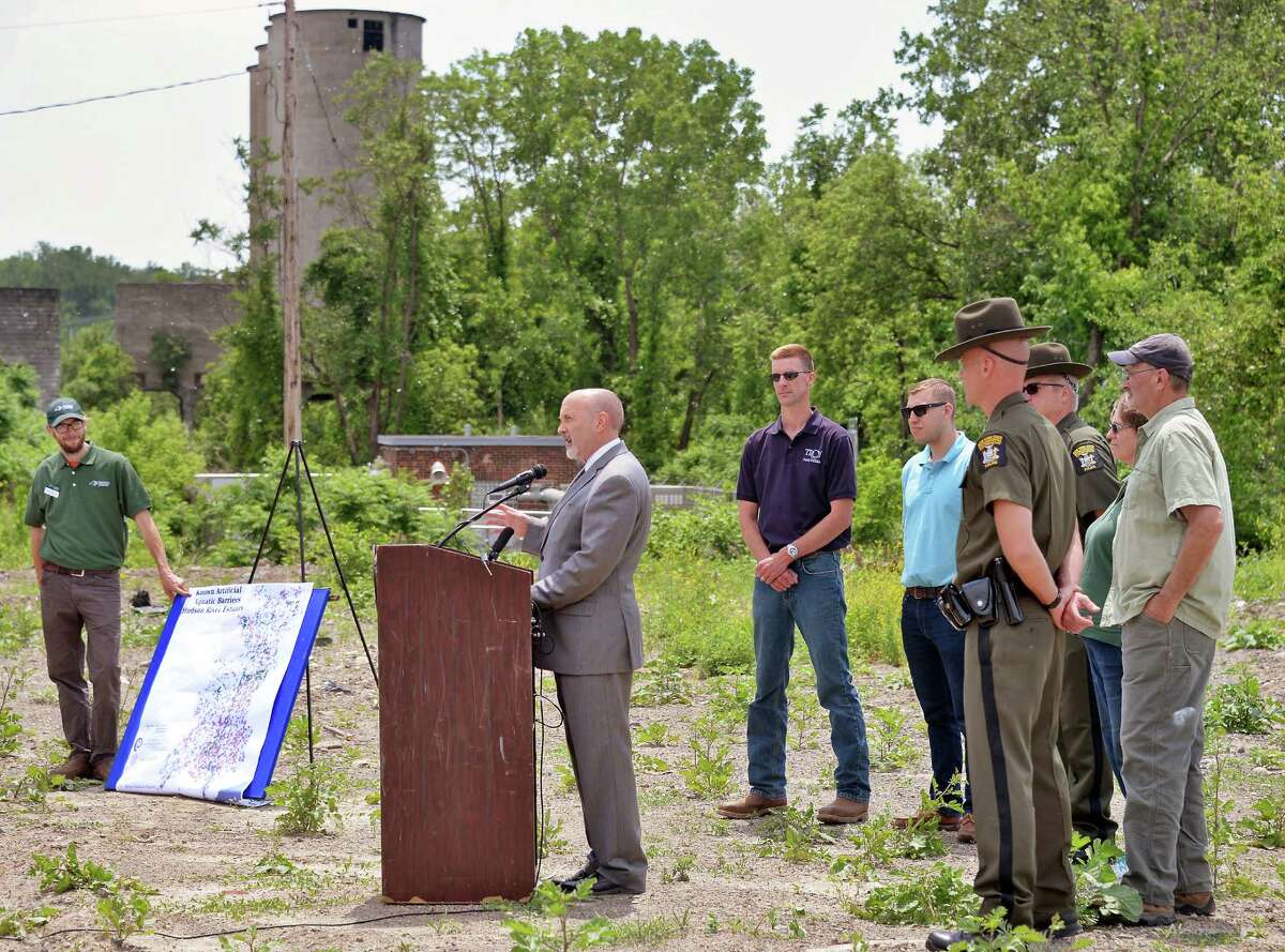 Mayor Patrick Madden, center, announces the collaboration of Riverkeeper, NYS DEC and the City of Troy to remove a Tainter gate dam on the Wynants Kill, restoring more than a quarter mile of spawning habitat for river herring for the first time in 85 years during a news conference Thursday June 2, 2016 in Troy, NY. (John Carl D'Annibale / Times Union)