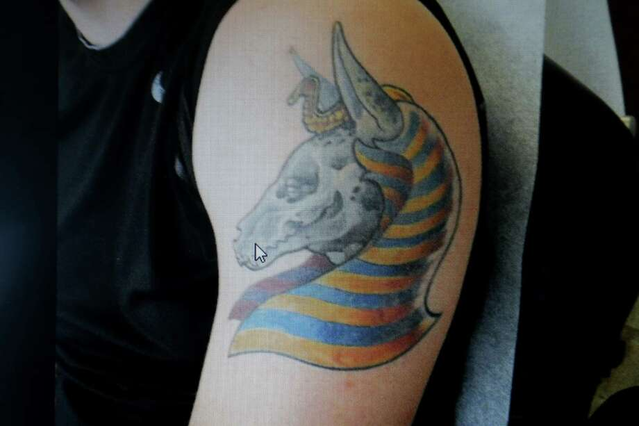 BEFORE  A tattoo of Anubis Photo: Gary Coronado, Staff / © 2015 Houston Chronicle