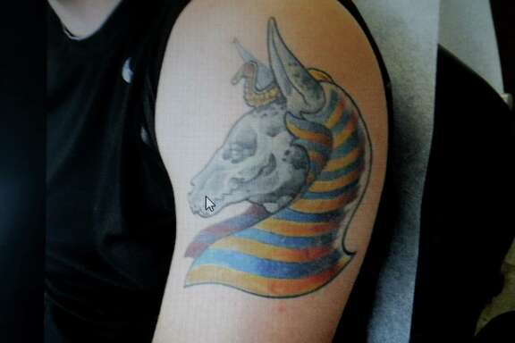 BEFORE  A tattoo of Anubis