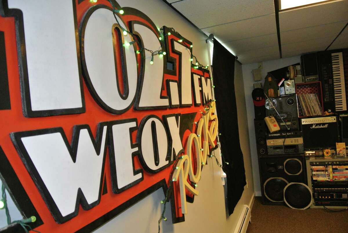 A vintage WEQX sign, a relic from the days of Brooks Brown, hangs in Studio BB on Wednesday, May 18, 2016.