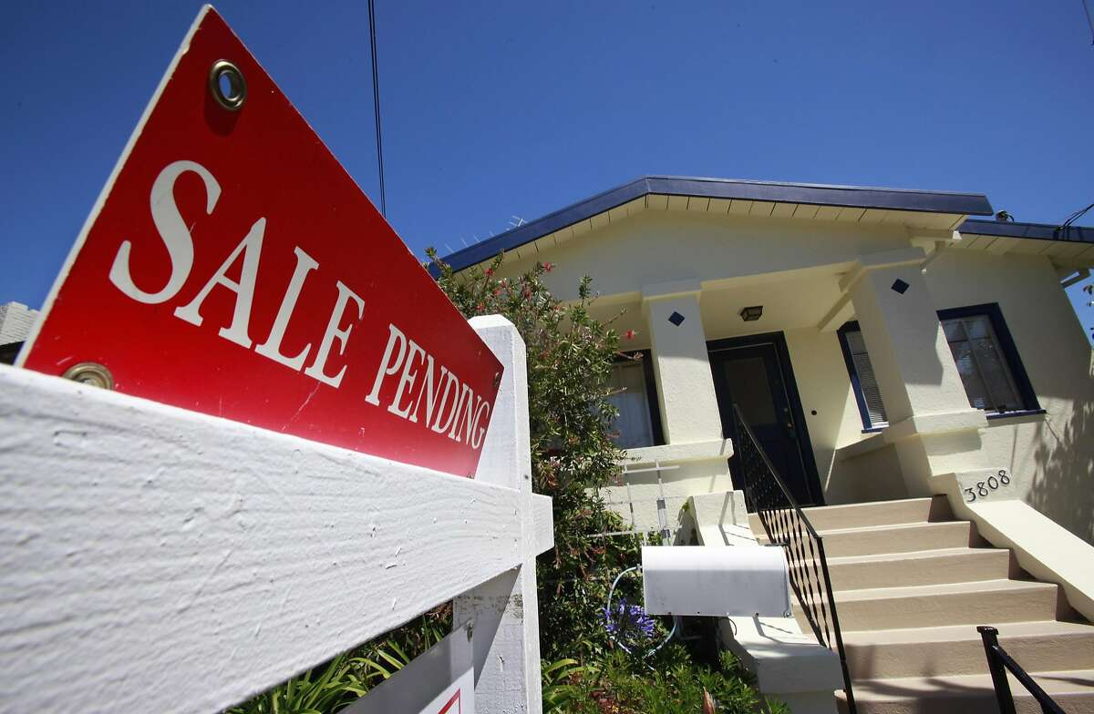 File photo of a house with a sale pending sign outside in Oakland, Calif.