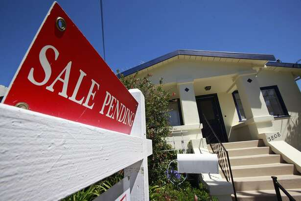 This photo made June 28, 2010, shows a house with a Sale Pending sign outside in Oakland, Calif. (AP Photo/Paul Sakuma)