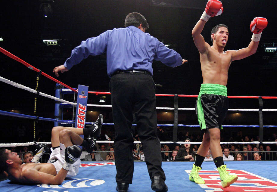 San Antonio's Kendo Castaneda (right) reacts after knocking down Albert Romero during the fourth round of their lightweight fight on Oct. 27, 2012 at the Freeman Coliseum. Photo: Edward A. Ornelas /San Antonio Express-News / © 2012 San Antonio Express-News