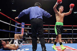 San Antonio's Kendo Castaneda (right) reacts after knocking down Albert Romero during the fourth round of their lightweight fight on Oct. 27, 2012 at the Freeman Coliseum.