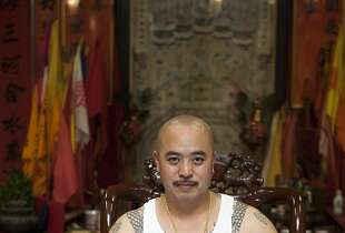 """In this image provided by Jen Siska, Raymond """"Shrimp Boy"""" Chow, is seen posing for a portrait in San Francisco in July 2007.  Investigators say Chow is the leader of one of the most powerful Asian gangs in North America. Chow's gang is said to have lured state Sen. Leland Yee into its clutches through money and campaign contributions in exchange for legislative help, as Yee sought to build his campaign coffers to run for California secretary of state. Yee and Chow were both arraigned on federal gun and corruption charges on Wednesday, March 26, 2014. (AP Photo/Jen Siska) MAGS OUT NO SALES NO ARCHIVE"""