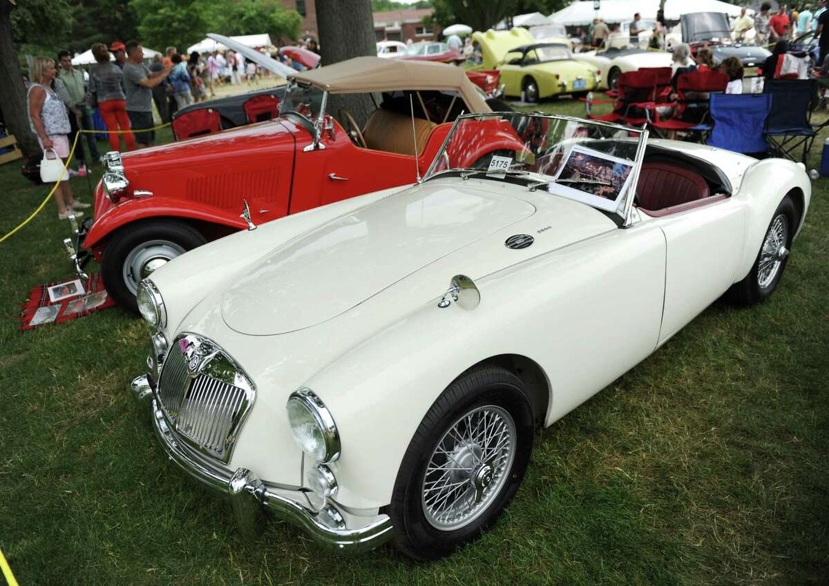 Photos the second day of the Concours d'Elegance car show at Roger Sherman Baldwin Park in Greenwich, Conn. Sunday, May 31, 2015. The 20th annual show featured an immense variety of vintage and modern cars with a focus on American vehicles the first day and international vehicles the second day. The display included sports, touring and competition cars, many of which are one of a kind, limited production or custom-built for celebrities.