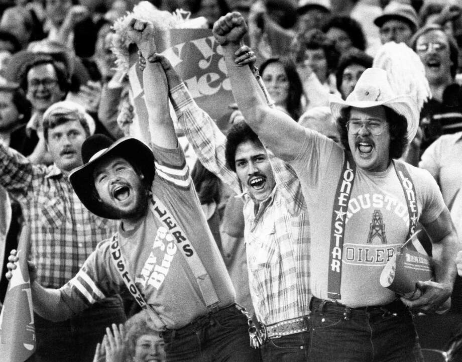 """12/1980 - Elated Oilers """"Luv ya Blue"""" fans celebrate a win at the Astrodome Photo: HC Staff / Houston Chronicle"""