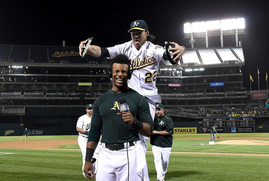 Khris Davis #2 of the Oakland Athletics is hit with cream pies by Josh Reddick #22 after Davis hit a walk off grand slam home run against the Texas Rangers in the bottom of the ninth inning at O.co Coliseum on May 17, 2016 in Oakland, California. Photo: Thearon W. Henderson
