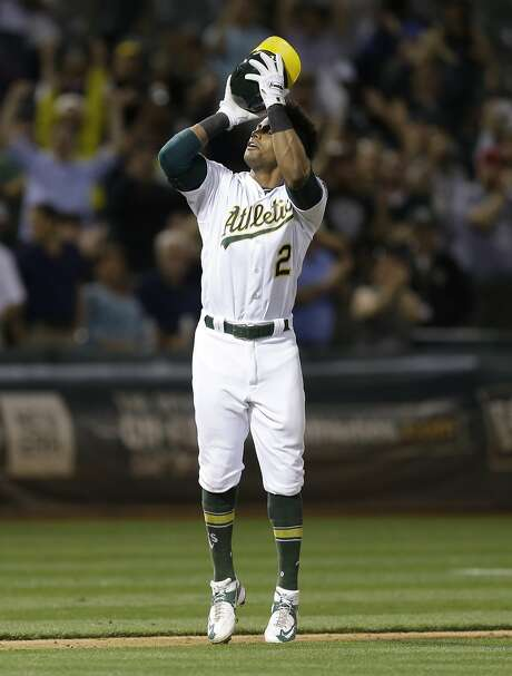 Oakland Athletics' Khris Davis celebrates after hitting a walk-off grand slam against the Texas Rangers during the ninth inning of a baseball game Tuesday, May 17, 2016, in Oakland, Calif. The A's won 8-5.(AP Photo/Ben Margot) Photo: Ben Margot, Associated Press