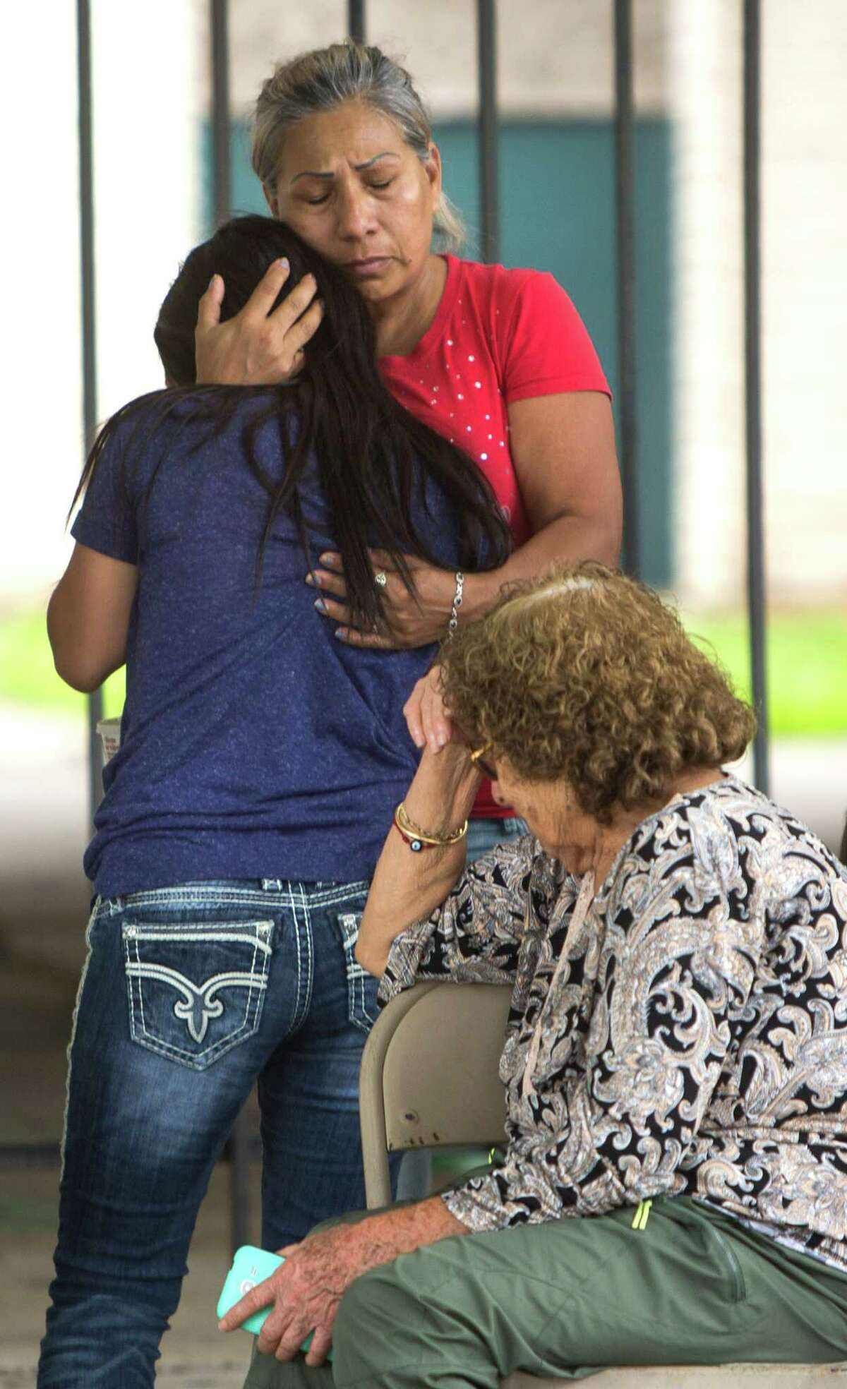 Loved ones grieve for Karen Perez on Tuesday in Houston after the 15-year-old was found dead in an abandoned apartment complex. Experts in juvenile law say her boyfriend, also 15, is likely to be charged as an adult.